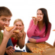 Stock Photo: Friends having fun and eating pizza