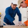 Stock Photo: Construction worker doing measuring