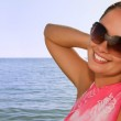Young beautiful woman at the beach — Stock Photo