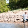 A fisherman fishing on a river — Stock Photo