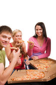 Friends having fun and eating pizza — Stock Photo