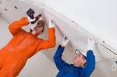Trabalhadores da construção civil no trabalho — Fotografia Stock