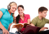 Group of students having fun, doing home work — Stock Photo