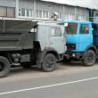 Stock Photo: Grey, blue and orange trucks