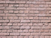 Red brick wall background at day — Stock Photo