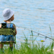 Little boy with fishing rod — Stock Photo #3221555