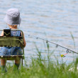 Little boy with fishing rod — Stock Photo #3221571