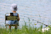 Little boy with fishing rod — Stock Photo