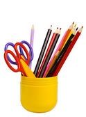 Some scissors and pencils in a cup — Stock Photo