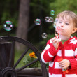 Little girl and bubbles — Stock Photo