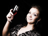 Elegant woman holding wine — Foto Stock