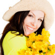 Spring woman holding flowers — Stockfoto