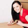 Woman holding and packing boxes — Stock Photo #3098578