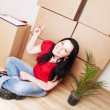 Stock Photo: Wommoving to new house