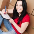Woman moving to new house - Stock Photo