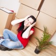 Young woman moving to new house — Stock Photo #3098643