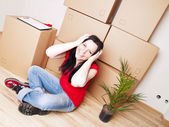 Young woman moving to new house — Stock Photo