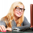 Woman in big glasses working on computer — Stockfoto