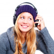 Blond woman with headphones listening music over white — Stock Photo