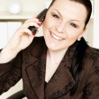 Smiling businesswoman calling by phone — Stock Photo