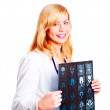 Female doctor examining x-ray picture over white — Stock Photo #3439391