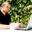 Man working with laptop outside - Photo