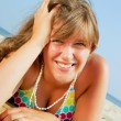 Smiling young woman on the beach — Stock Photo