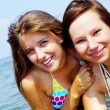 Two women friends have a fun in sea — Stock Photo