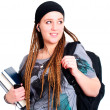 Teenager student holding backpack, books and looking on left — Stock Photo #3592504