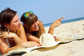 Two girls on the beach — Stock Photo