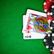 Black and red poker chips with cards in the back — Stock Photo