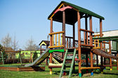Colorful wooden playground for children — Stock Photo