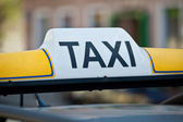 Taxi sign on a car roof - close-up — Stock Photo