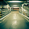 Parking garage, underground interior with a few — Stock Photo