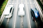 Cars in motion blur on a street of Wroclaw - cit — Stock Photo