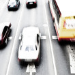 Cars in motion blur on a street of Wroclaw - Stock Photo