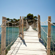 Wooden bridge with ropes over a sea in Zakhyntos - Stock Photo