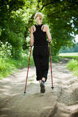 Nordic walking in summer nature — Stockfoto