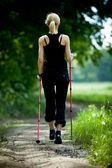 Nordic walking in summer nature — Stock fotografie