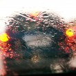 Car windshield in traffic jam during rain — Stock Photo