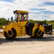 Heavy Vibration roller at asphalt pavement works (road repairing - Stock Photo