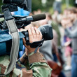 News maker on reportage recording with camcode — Stock Photo