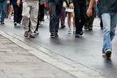 Crowd walking - group of walking together (motion blur) — Stock Photo