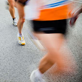 Running in city marathon - motion blur — Stock Photo
