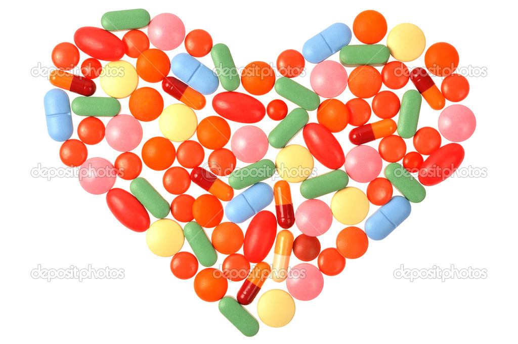 Heart shape made from pills isolated on white  Stock Photo #3102844
