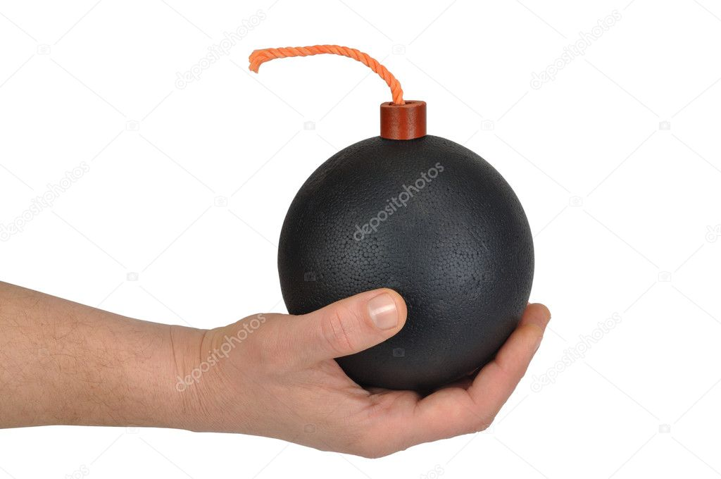 Hand holding black ball resembling a bomb with fuse — Stock Photo #3304308