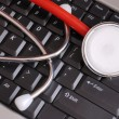 Stethoscope on Keyboard - Stok fotoğraf