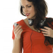Royalty-Free Stock Photo: Woman listening music from mp3 player