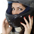 Stock Photo: Young woman in a motorcycle helmet