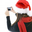 Young woman in Christmas cap with camera — Stok fotoğraf